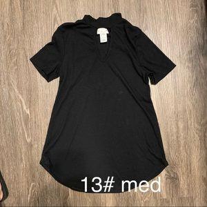 Black blouse, V peek at neckline… Small – medium